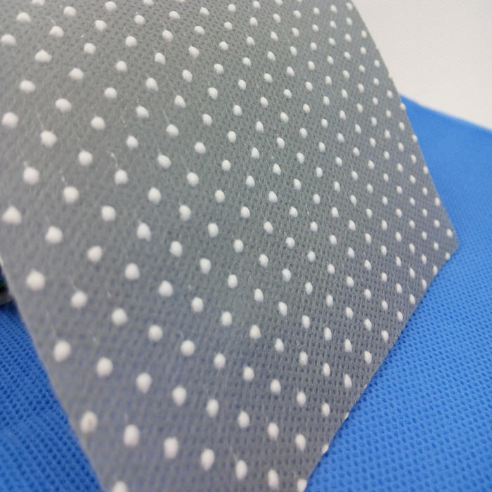 manufacturer anti slip interlining TNT spunbond 100% PP nonwoven fabric with dots