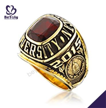 Gold plated university students red stone wedding rings