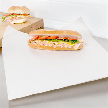 white baking paper coating side non-stick with food in the oven