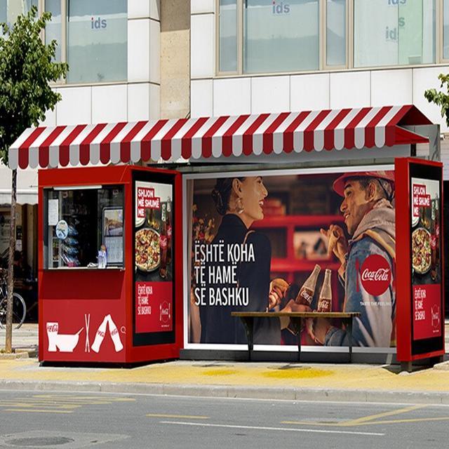 Outdoor advertising bus shelter with vending kiosk
