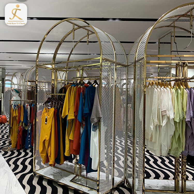 high end custom gold stainless steel storage rack shelf for garment clothes stainless steel metal clothes display rack