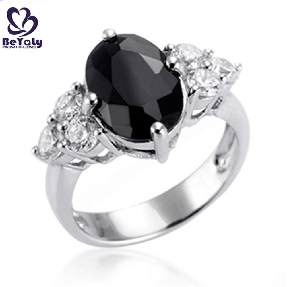 Brilliant black oval stone with wing design vintage diamond rings