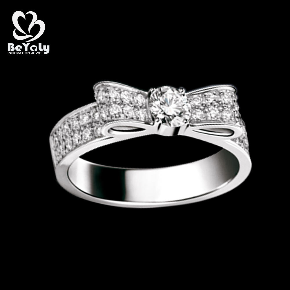 Simple bespoke bow design cubic zirconia 925 silver wedding rings