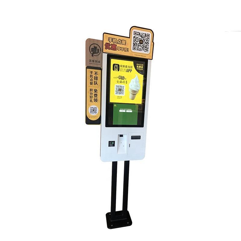 Standing kiosk with QR code reader in restaurantwith internet interface
