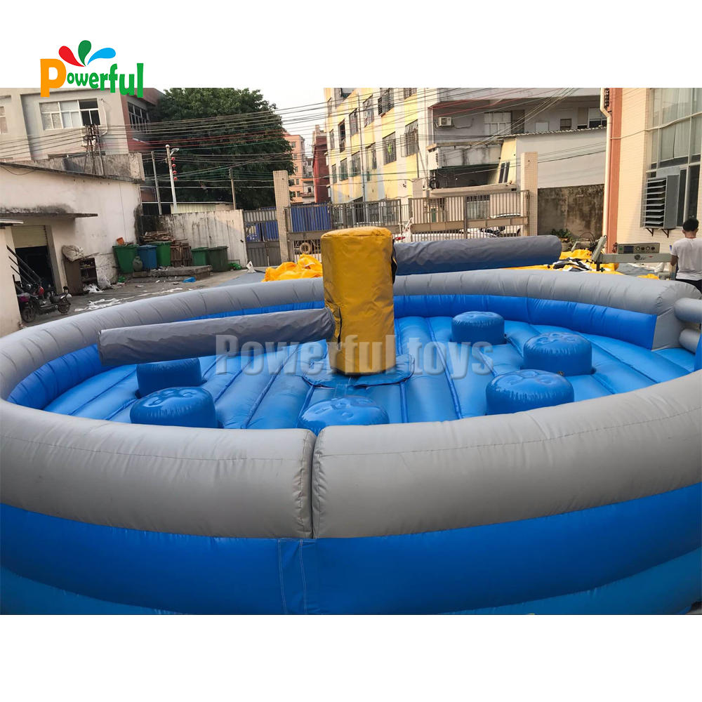 Inflatable last man standing wipeout machine challenge for team building game