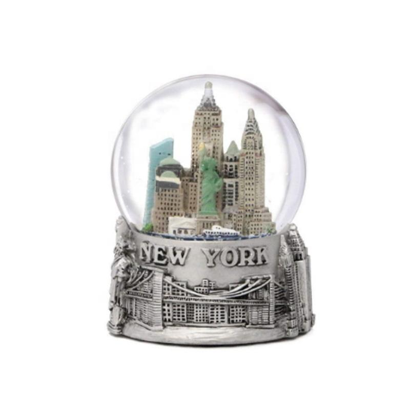 Amazon hot sale resin Christmas snow globe with building inside