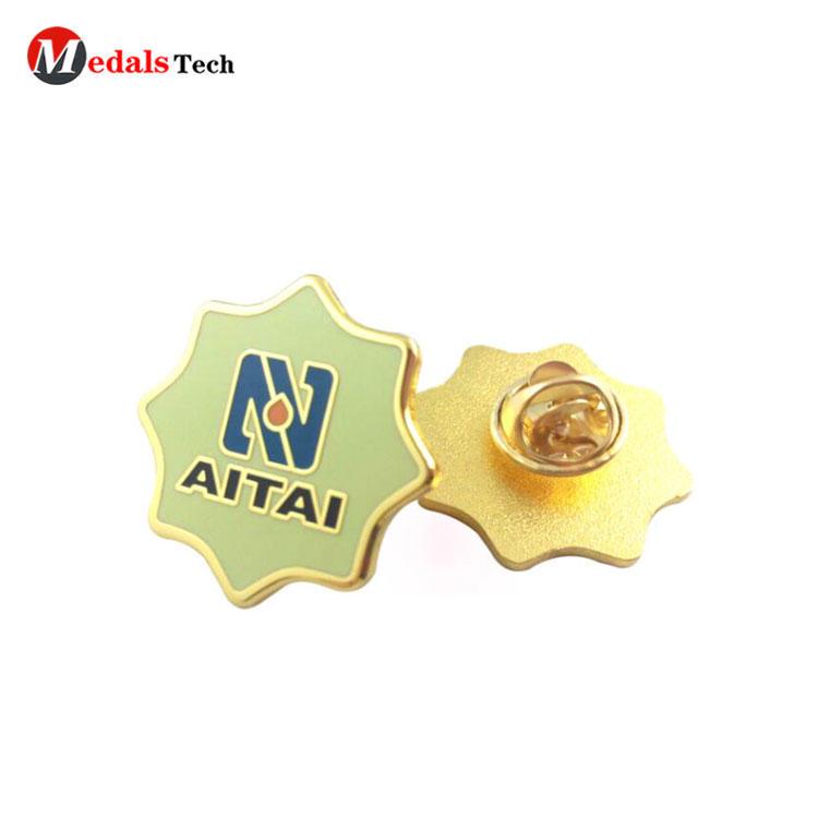 Hot sale star shape metal hard enamel fist lapel pin badge for souvenir