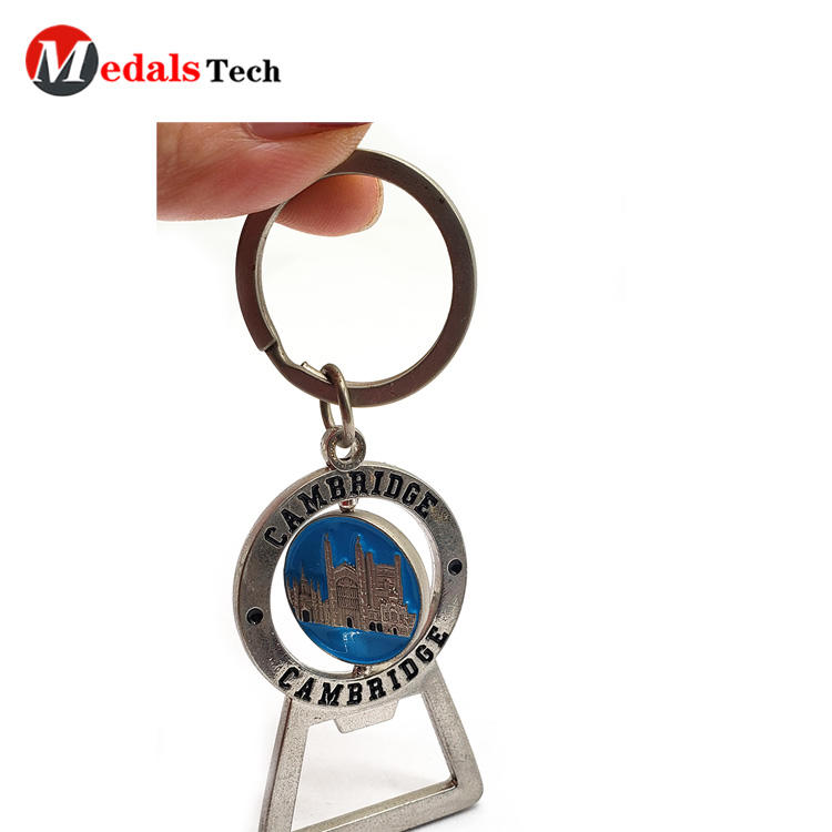 Cheap metalkeychain pocket bottle opener with spinning badge