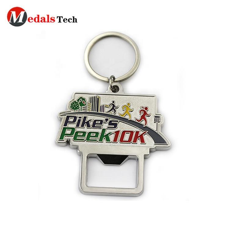 Promotional popular design metal embossed logo Anniversary souvnir keychain silver plated pocket bottle opener