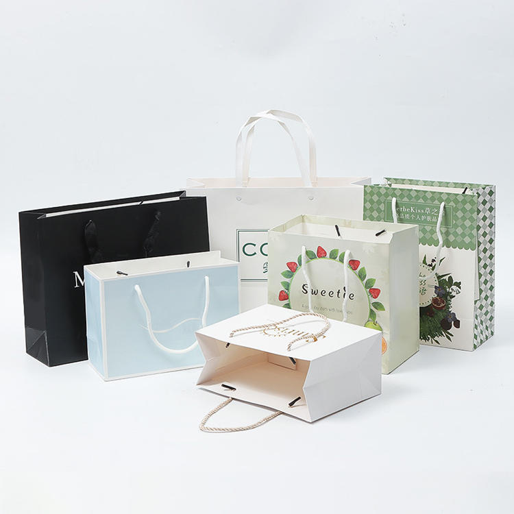 Custom Clothing Paper Bags with Logo Print Packaging Gift Foldable White Cardboard Bag Reusable Shopping Bag with Ribbon Handle