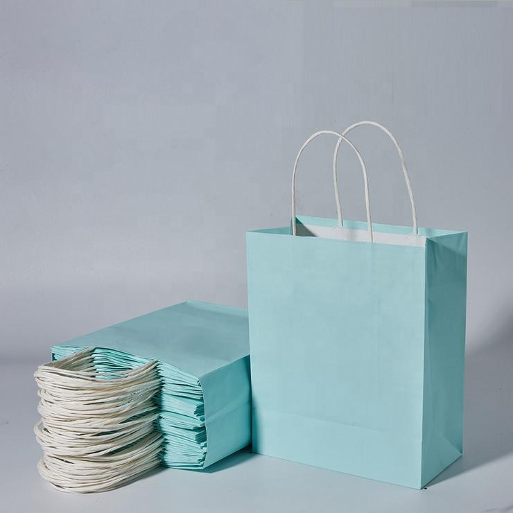 China Manufactures Small White Luxury CarrierCustom Logo Printed Paper Gift Bag With Handle