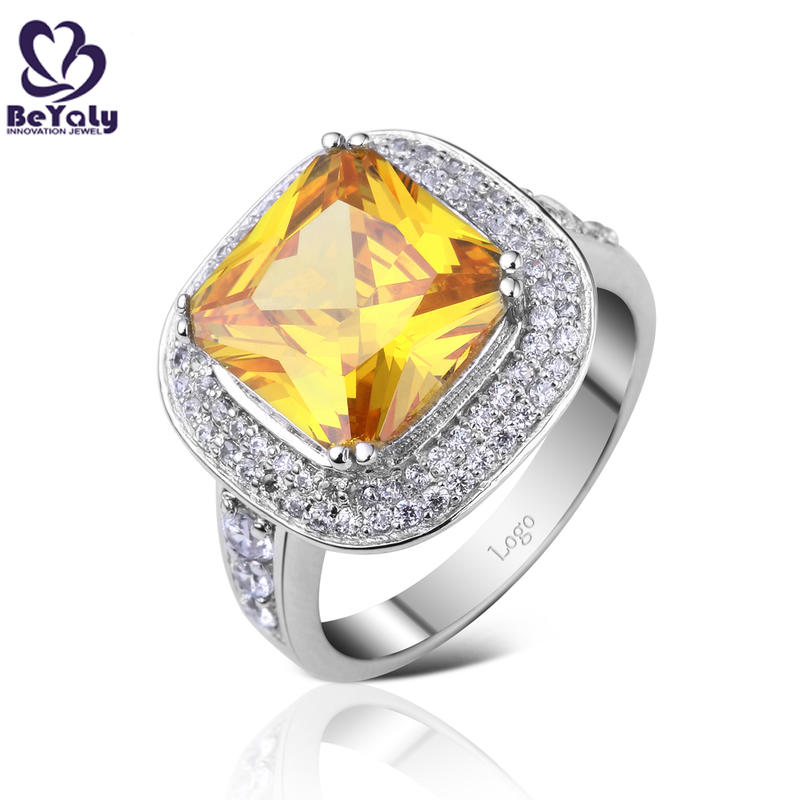 Noble style yellow gemstone silver ring with cz stones