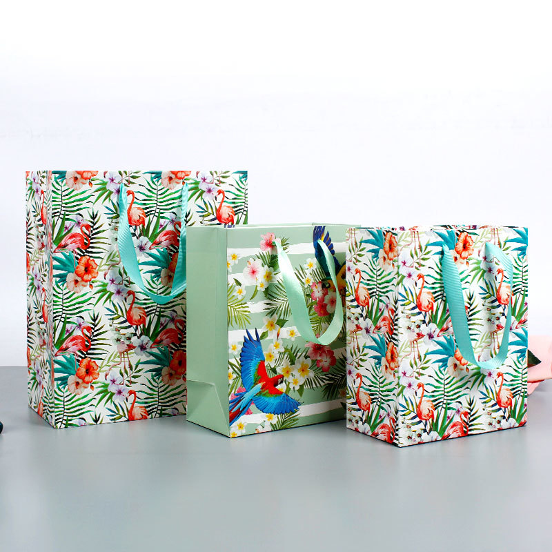 Custom Made Paper Bags Of Daily Design With Matt Foil Lamination With Ribbon Handles