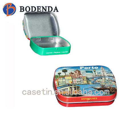 small rectangular peppermint candy in tin can with hinged lid