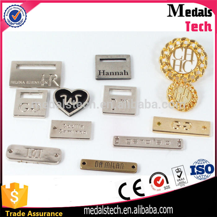 Hot Sell custom embossed alloy material antique metal brand logo label sew