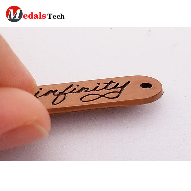 Custom cheap antique copper thin engraved logo clothing metal label