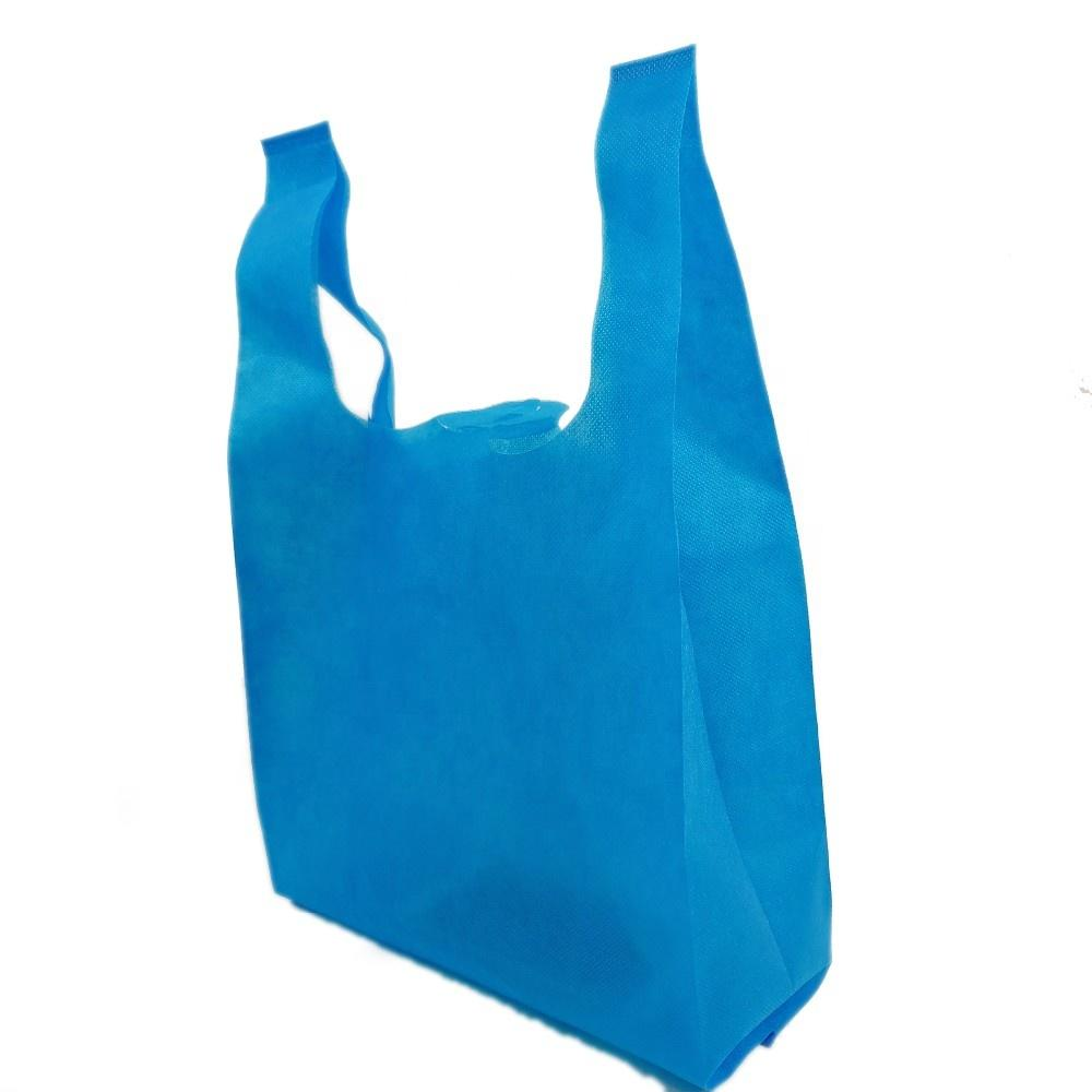 Good sell customized popular eco-friendly reusablevast bags/ cheap biodegradable non woven t-shirt shopping bag