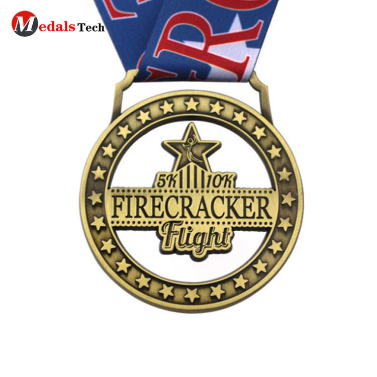 Cheap custom hollow out round antique firecracker flight 5k 10k embossed logo soft enamel finisher medal gold