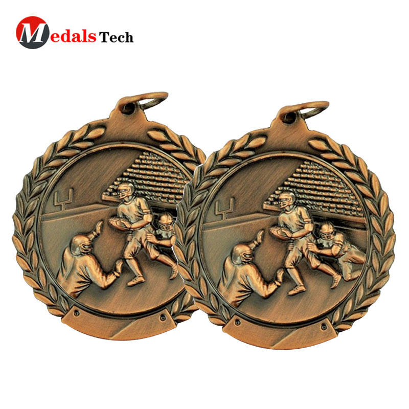 Factory direct sale high quality 3d embossed logo metal rugby football antique gold medal