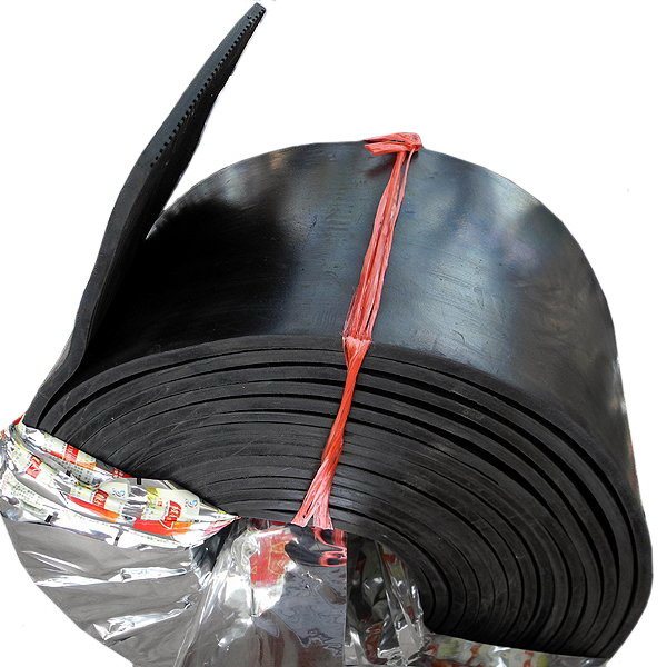 Rubber plate for reducing the impact of crane running
