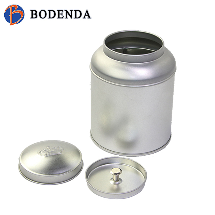 large plain empty tea storage tins