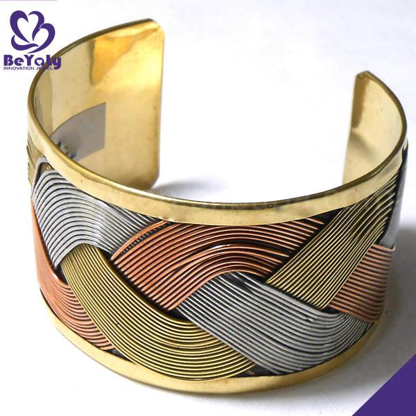 Twist raised grain design gold bangles designs price