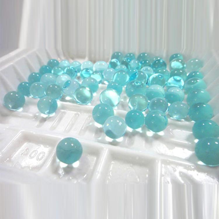 Pink water absorbing polymer beads
