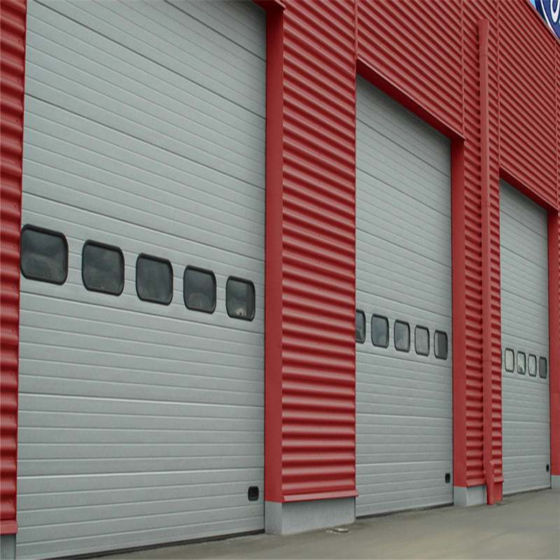 Electric industrialsectional door 129inch*125inch white color with a small door and three view windows