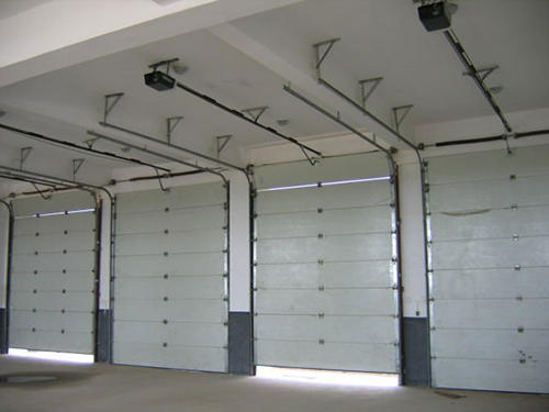 Automatic PPGI with PU Foam Vertical Factory Price Industrial Lifting Door Manufacturer