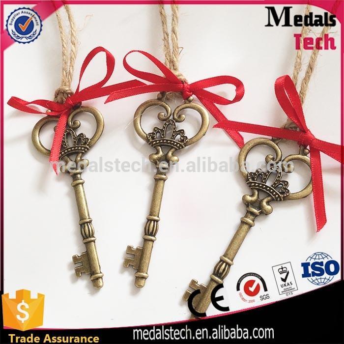Hot sale 2017 alloy red ribbon bulk enamel christmas key ornament for kids