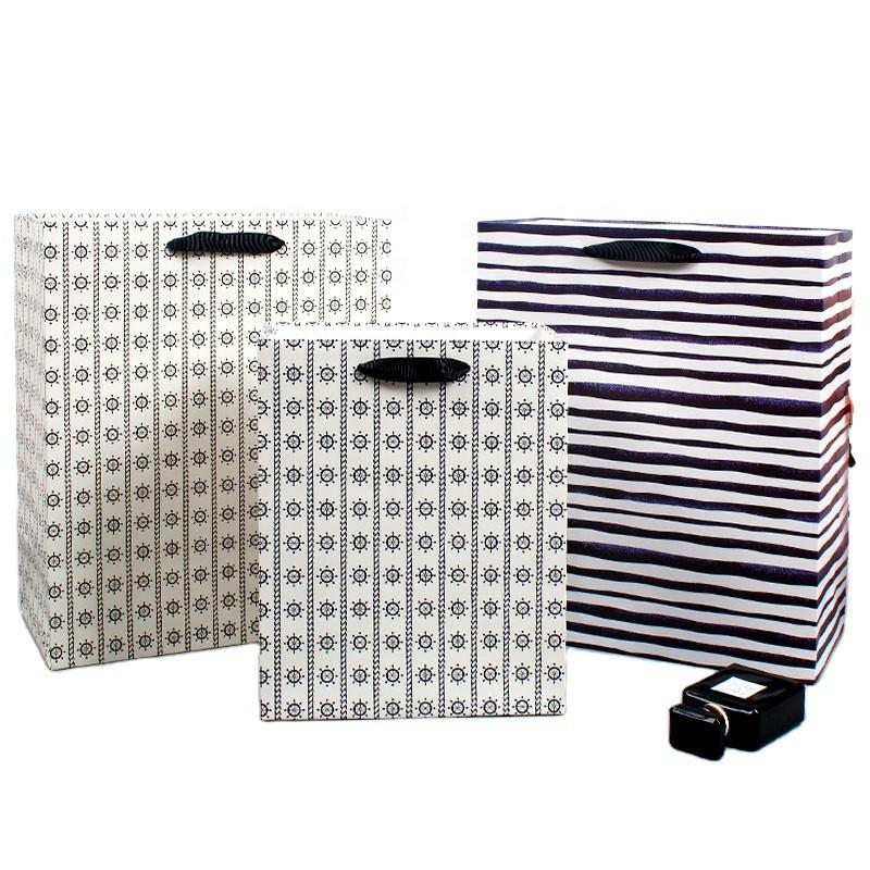 Factory direct stripe paper handbag contracted gift bag packaging bag shopping bag new handbag foreign trade