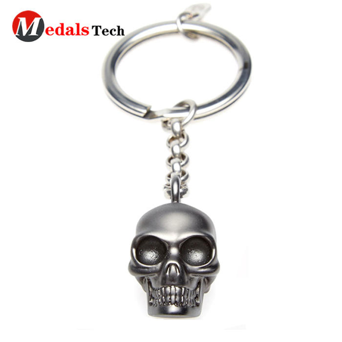 Promotional unique lovely custom skulls head metal keychain