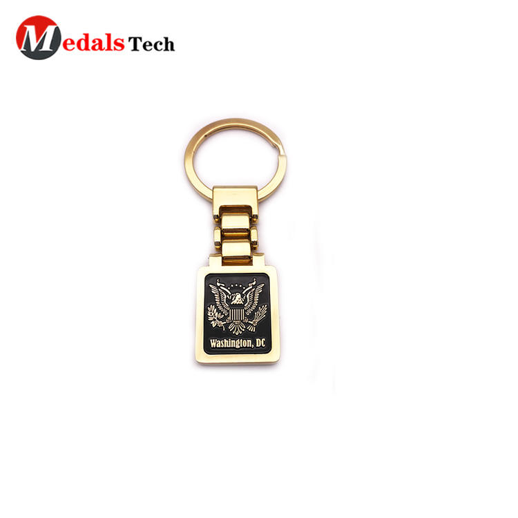 Custom embossed logo shinny gold finish tourist souvenir keychain