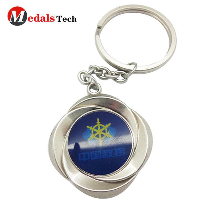 Custom made logo cheap round shaped metal souvenir keychain