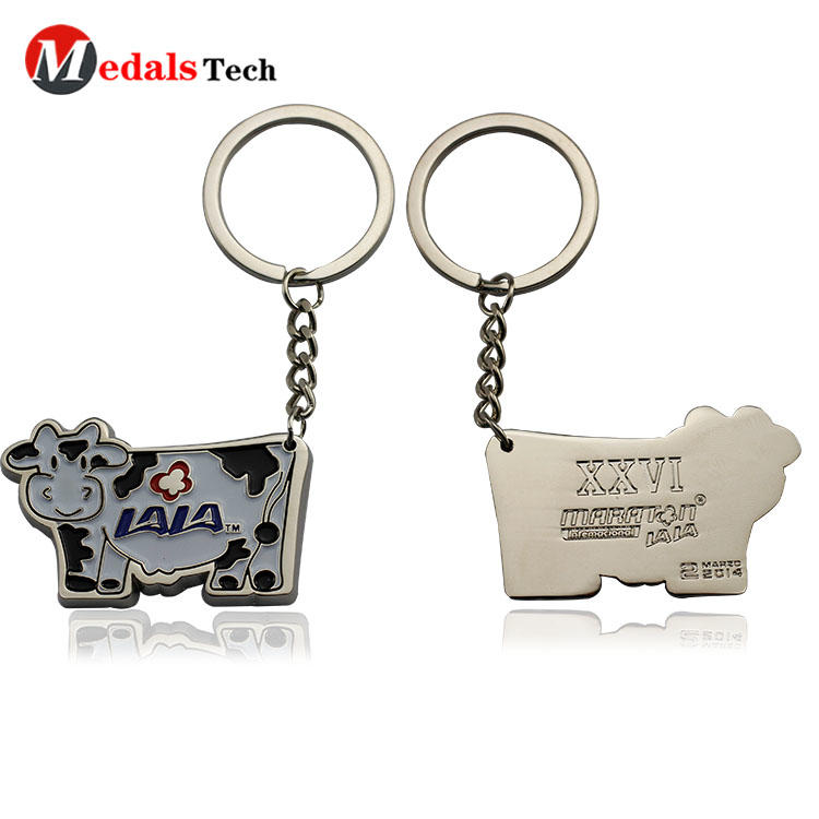 Wholesale cute cow shaped engraved logo souvenir metal keychain