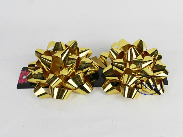 Iridescent various size star gift bow and ribbon bows wrapping present