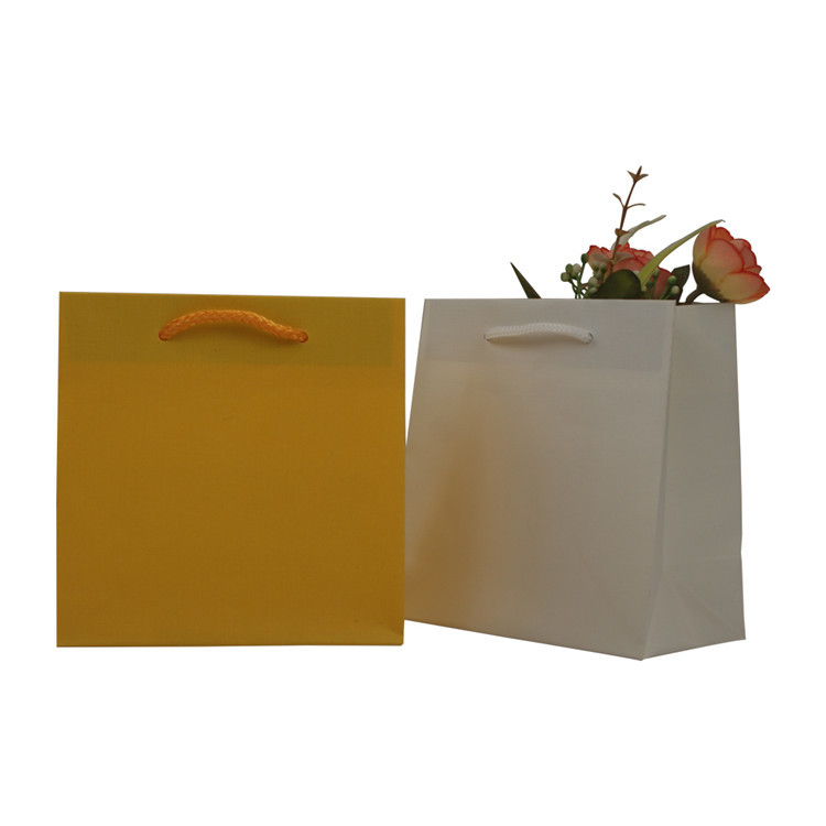 High quality eco friendly material strong kraft paper shopping bag with handle