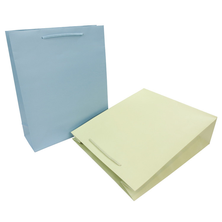 Wholesale paper shopping bag custom cheap kraft paper packaging bag with handle