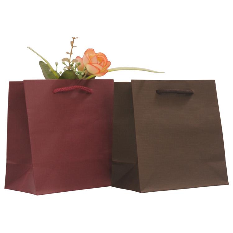 Wholesale luxury custom gift packaging storage kraft shopping paper bags
